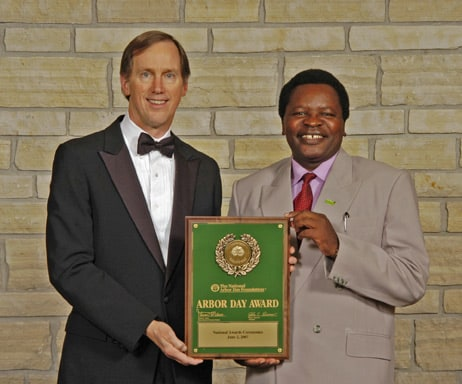 John Rosenow, president of the National Arbor Day Foundation, presents J. Sterling Morton Award plaque to Sebastian Chuwa