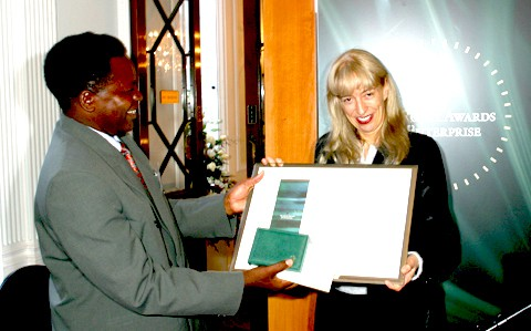 Baroness Susan Greenfield, Director of the Royal Institution in London, presents Sebastian with Rolex Award Certificate