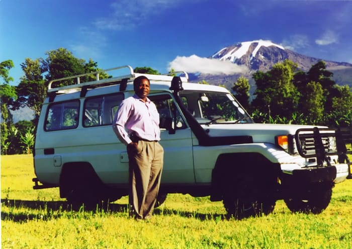 Sebastian poses with Toyota Landcruiser purchased with Rolex Award endowment