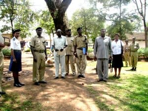 2012 - Sebastian Chuwa (r front) consults with officials of the Police Training School on occasion of mpingo tree planting initiative.