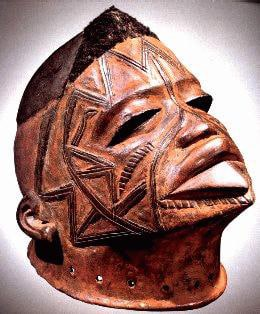 Makonde Lipiko Mask, showing facial scarification and stylized features
