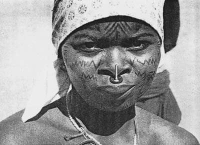 Ancient cultural tradition of Makonde - Facial scarification and blackwood noseplug in upper lip