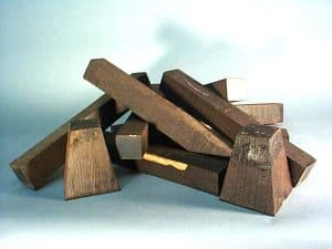 A stack of reject blanks from the musical instrument trade. 90% of the mpingo cut for this purpose ends up on the scrap pile. Some is diverted to native carvers for their use and others like these pieces are sold as imperfect pieces for other woodworking purposes such as woodturning, ornamental turning and knife handles.