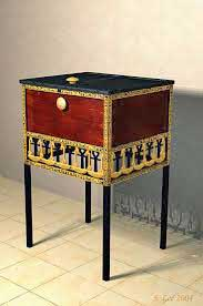 The long slender legs of this typical Egyptian cabinet are made of blackwood. Its bordering frames are carved in hieroglyphic inscriptions referring to the king.