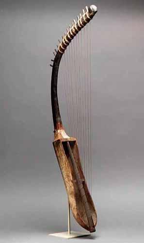 Neck of Egyptian Ebony Harp is made of African blackwood.