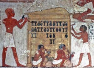 Rekhmire carpenters are carving Djed pillars and Isis knot ritual objects from African blackwood.