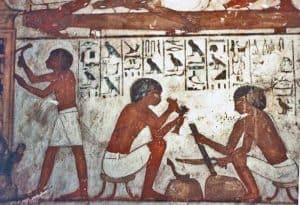 Detail - Carpenters working blackwood. Mural on wall depicts the Egyptian God Horus, the falcon, symbol of protection, royal power and good health.