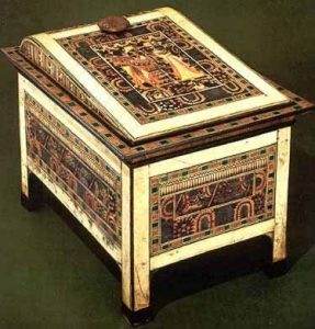 The surface of this chest is almost unsurpassed in its artistry and skill because it is nearly entirely decorated, using fine materials like ebony and ivory veneer, gold gilding, precious stones and beads. The designs depict the king and the queen in various activities.