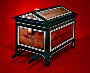 This portable chest is the only one in the collection with carrying poles beneath, thought to be because of the heavy weight of its contents. It is made of cedar and blackwood and decorated with blackwood and ivory veneer.